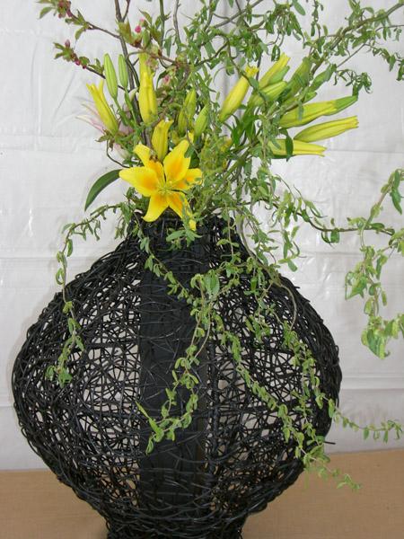 wild flowers in a wicker vase