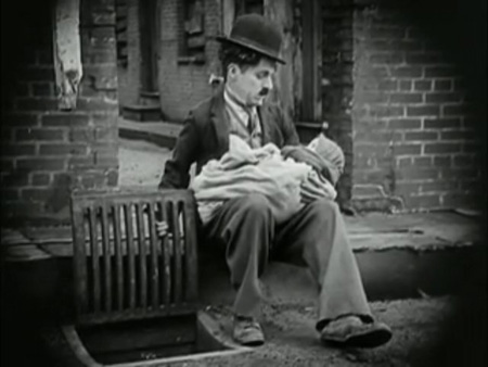Chaplin choosing fatherhood in The Kid (1921)