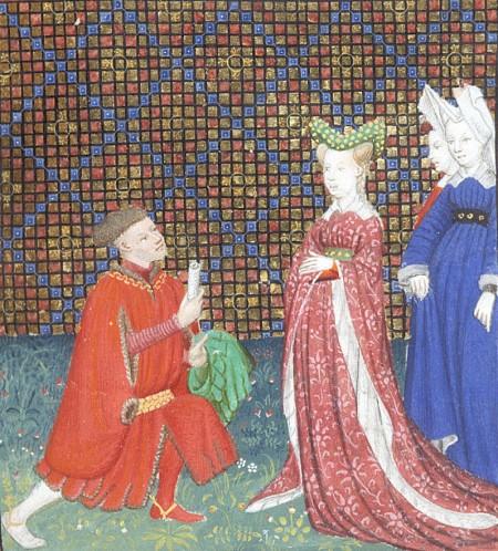 man knealing before two women