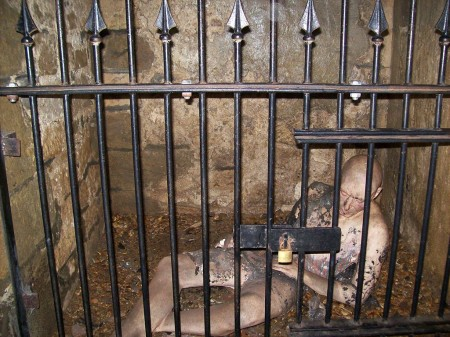 man imprisoned in medieval dungeon