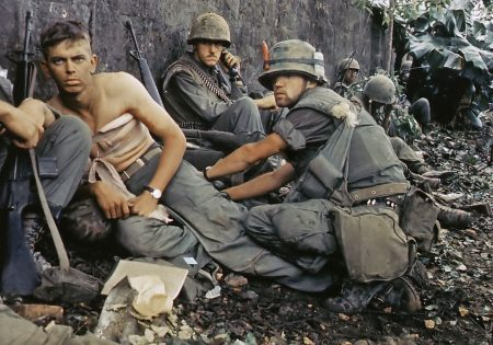 man treating another man's war wound