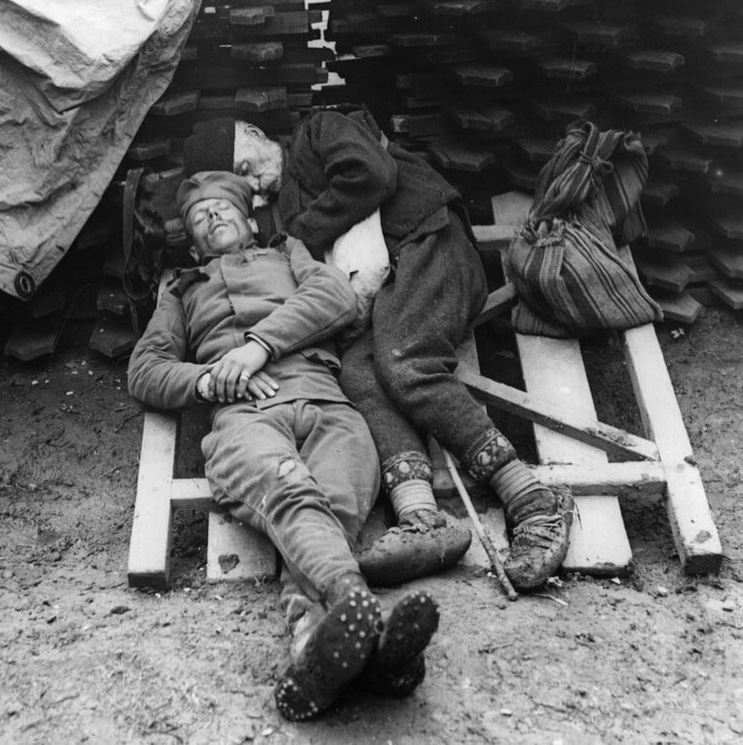 soldier and his father sleep together in trench