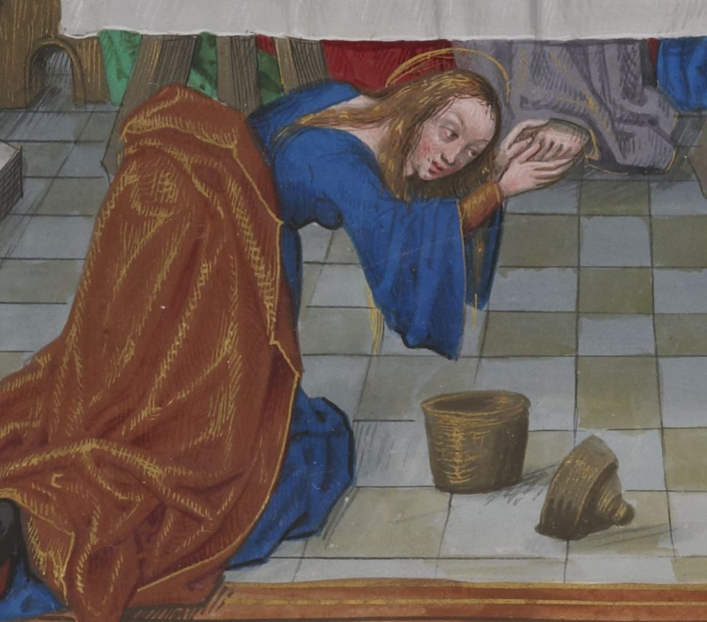 Mary anointing Jesus's feet with nard under a table at a dinner